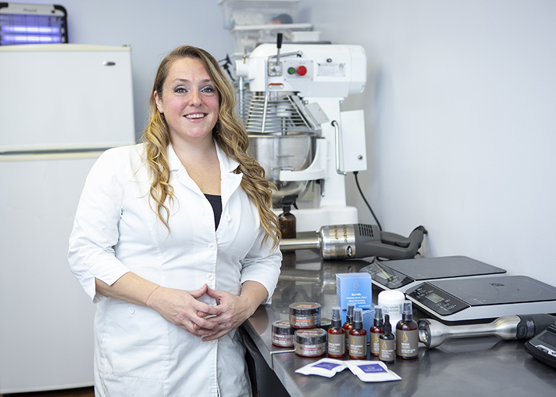 Eliza Desmarais, owner of Sohma Naturals, showcases products in her lab