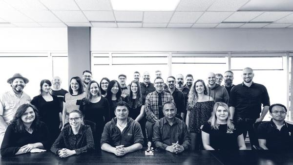 Team photo of QRA Corp employees